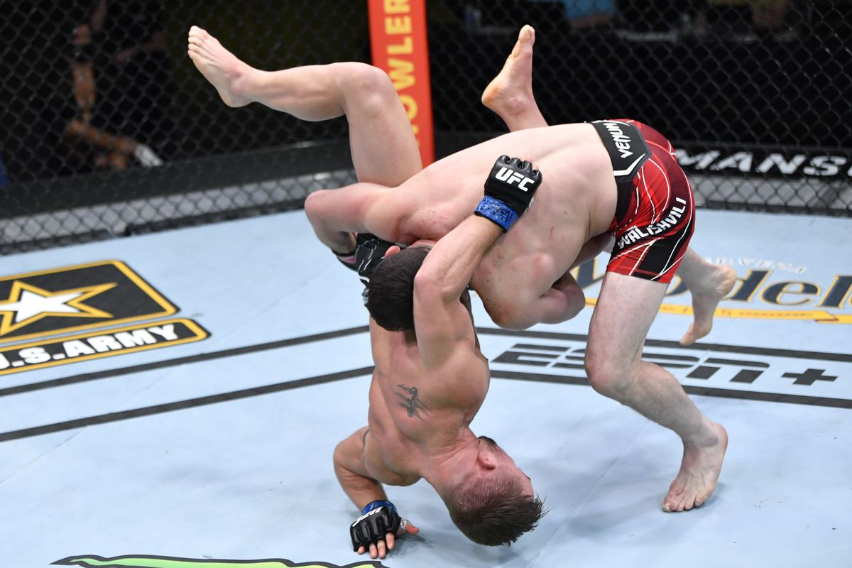 Merab Dvalishvili of Georgia takes down Cody Stamann in a bantamweight bout during the UFC Fight Night event at UFC APEX on May 01, 2021