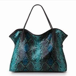 Rembos loves this snazzy vegan-python collection from Sorial. This Evelyn Tote ($79, available on OpenSky.com) comes with a wristlet that can be used as an evening bag.