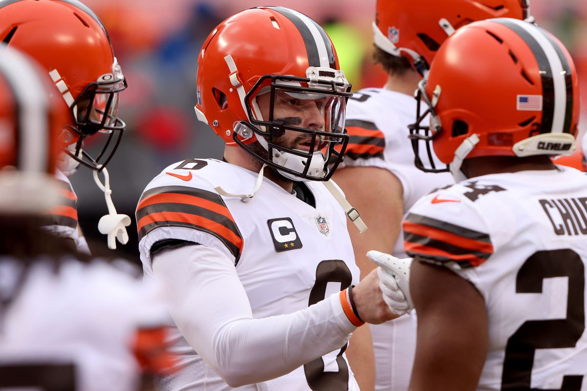 Quarterback Baker Mayfield #6 of the Cleveland Browns and teammates warm up prior to the AFC Divisional Playoff game against the Kansas City Chiefs at Arrowhead Stadium on January 17, 2021 in Kansas City, Missouri.