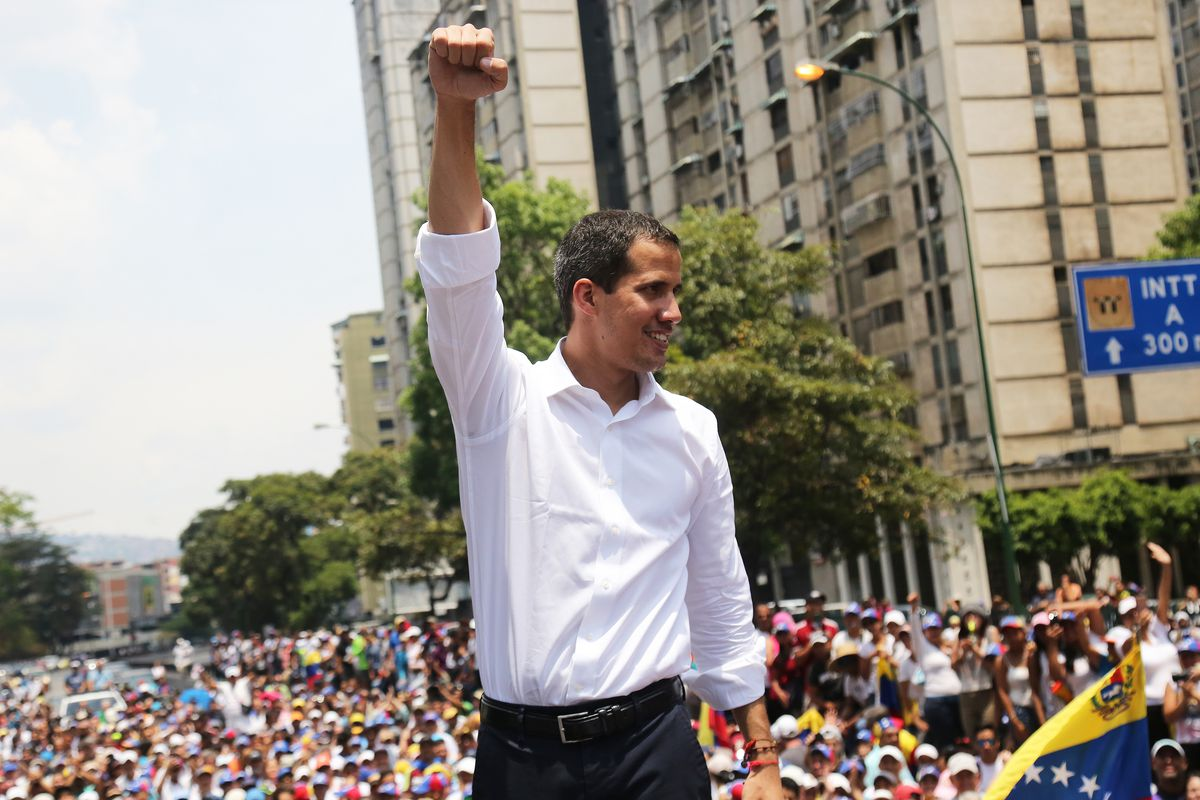 Venezuelan interim president Juan Guaidó waves his supporters during a demonstration on May 1, 2019 in Caracas, Venezuela.