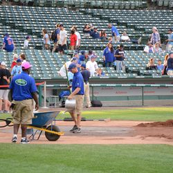 6:23 p.m. The grounds crew working the home plate area -