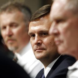 Dennis Lindsey, center, is introduced as the Utah Jazz General Manager at the Zions Bank Basketball Center in Salt Lake City, Tuesday, Aug. 7, 2012. At left is Greg Miller. At right is Kevin O'Connor.