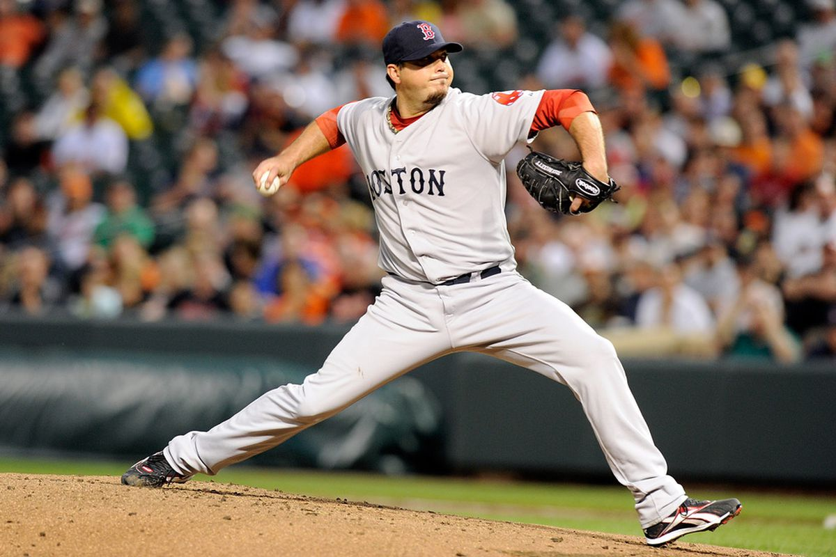 BALTIMORE, MD - APRIL 27:  Josh Beckett #19 of the Boston Red Sox pitches against the Baltimore Orioles at Oriole Park at Camden Yards on April 27, 2011 in Baltimore, Maryland.  (Photo by Greg Fiume/Getty Images)