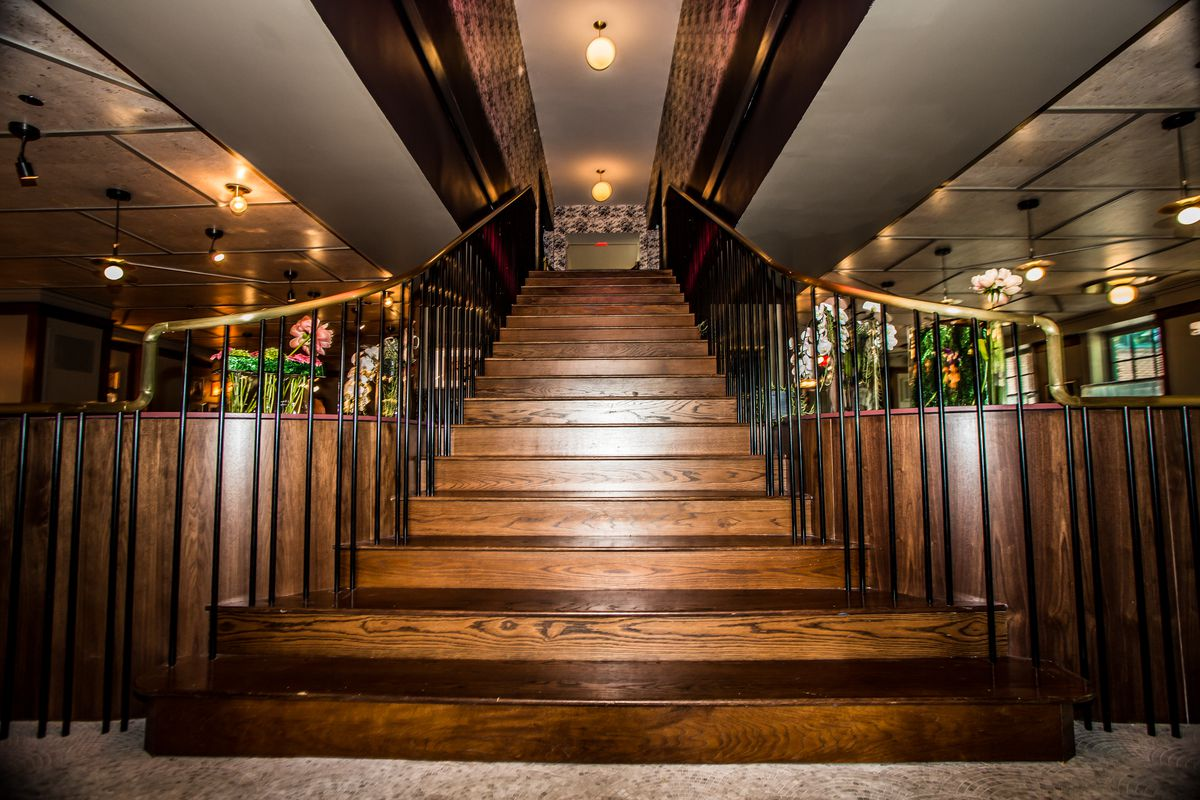 The staircase leading up from Tiny Lou's to the lobby and lobby bar of Hotel Clermont