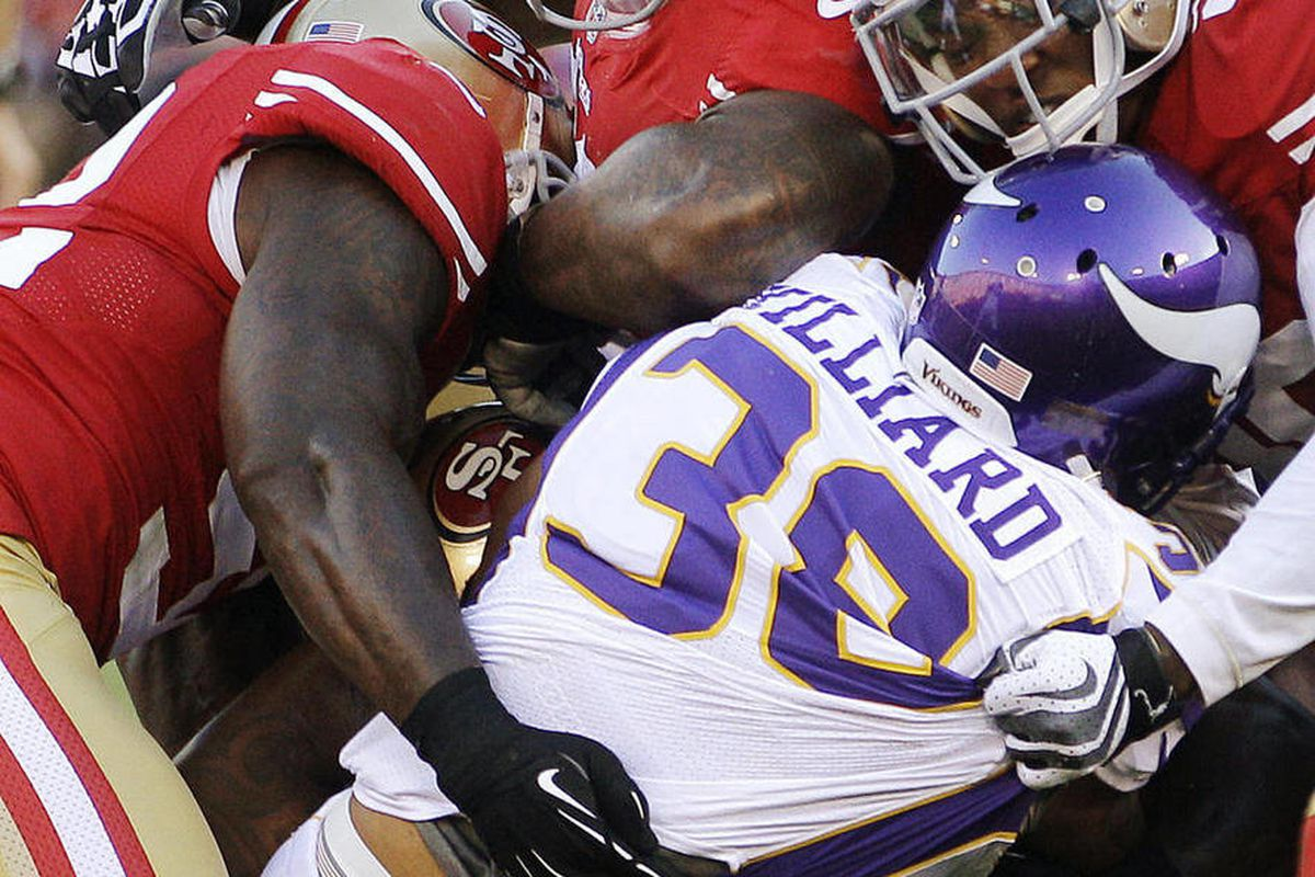 FILE - In this Aug. 10, 2012, file photo, Minnesota Vikings running back Lex Hilliard (38) is tackled by San Francisco 49ers linebacker Patrick Willis, left, linebacker Parys Haralson, top, and cornerback Chris Culliver during the first half of an NFL pre