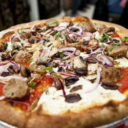 """Lombardi's pie with meatballs, onions, mushrooms, and olives by <a href=""""http://www.flickr.com/photos/nicknamemiket/6282095408/in/pool-eater/"""">nicknamemiket</a>. <br />"""