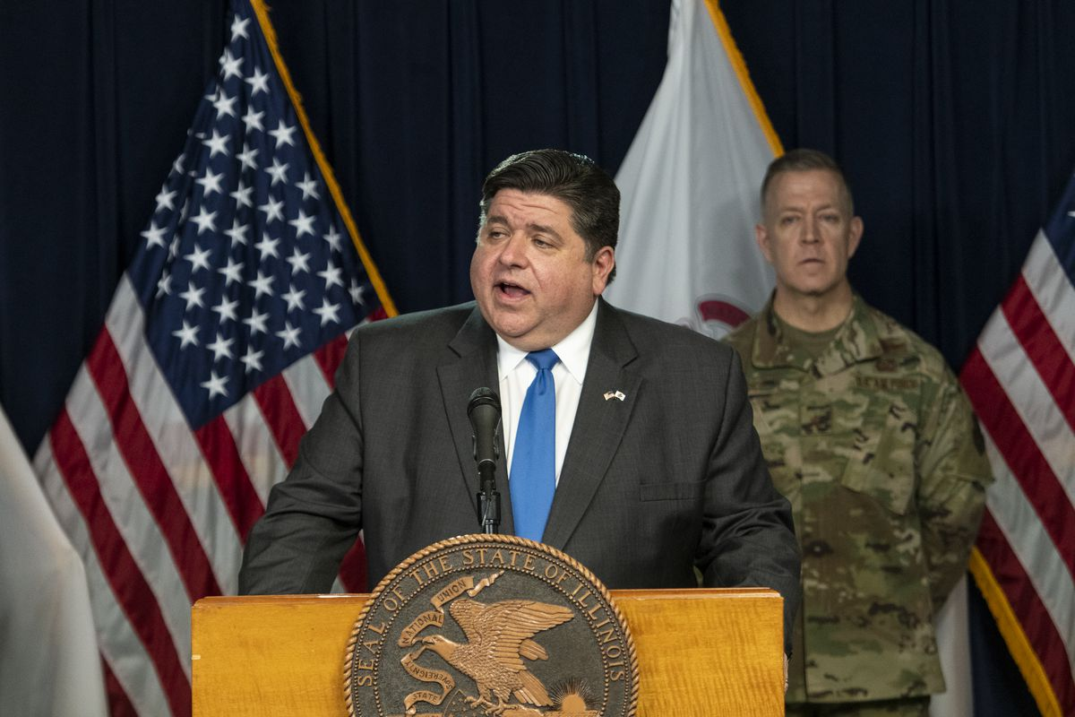 Gov. J.B. Pritzker, along with elected and health officials, is shown in March during a daily update on the coronavirus situation in Illinois.