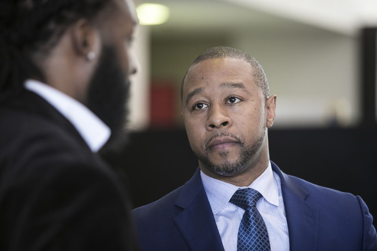 Attorney Jarrett Adams talks with a client at the Leighton Criminal Courthouse, Friday morning, March 9, 2018. | Ashlee Rezin/Sun-Times