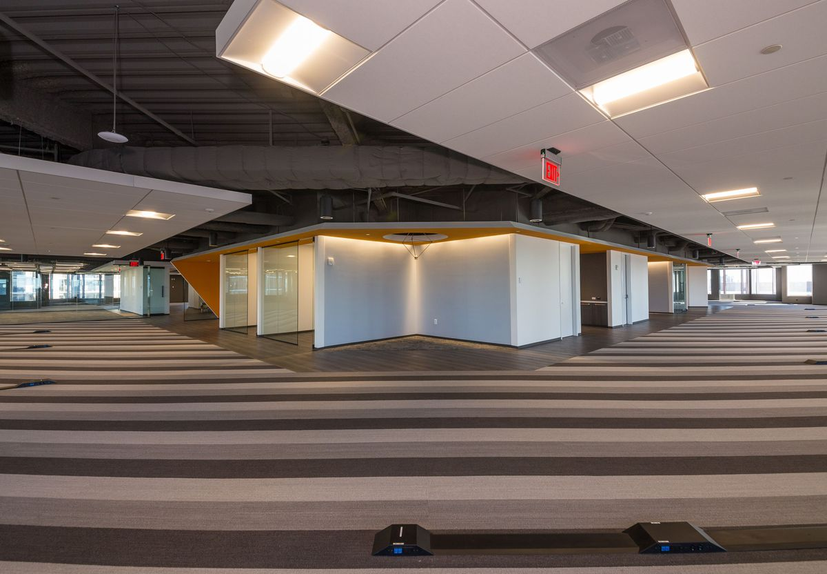 A wide-angle shot of a sprawling open-format office space.
