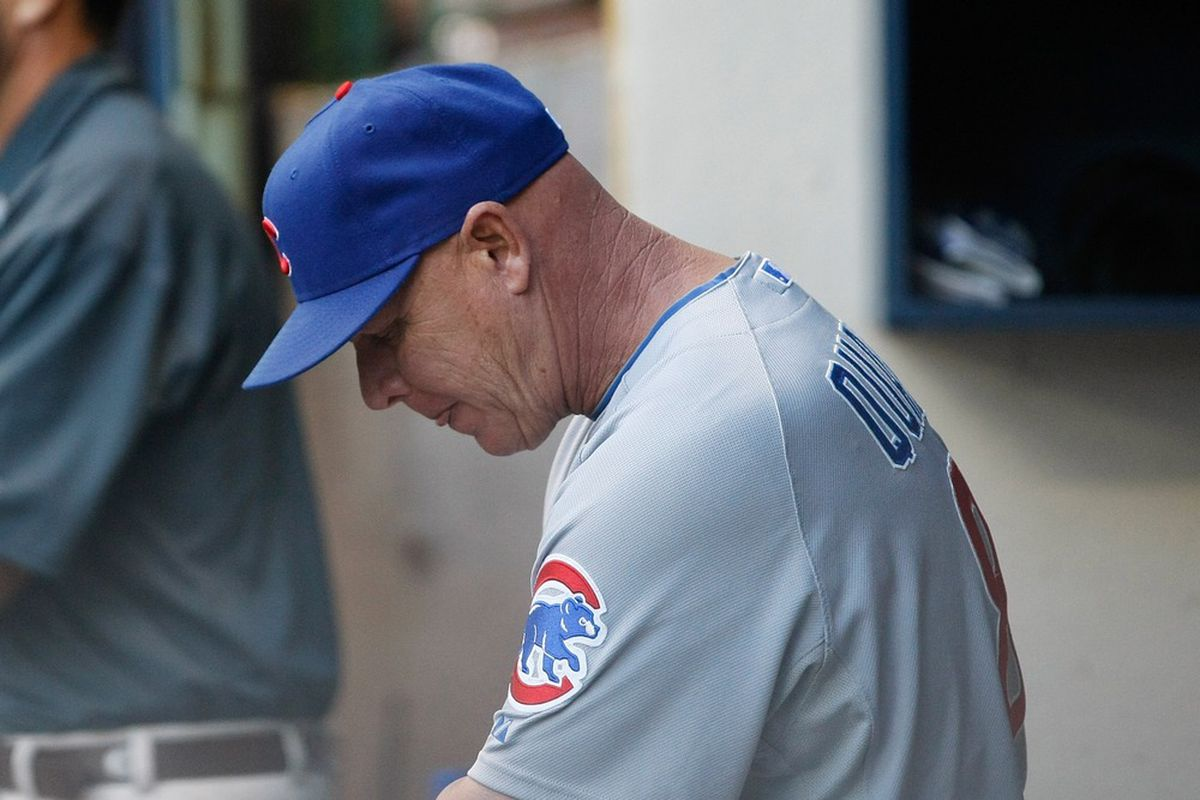 What is this man thinking? Mike Quade of the Chicago Cubs reacts after the Brewers score a run during a game against the Milwaukee Brewers at Miller Park in Milwaukee, Wisconsin. (Photo by Scott Boehm/Getty Images)