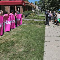 """Planned Parenthood supporters hold a banner as a demonstrator holds a poster saying """"Please Let Them Live,"""" while group called Women Betrayed holds a rally to support ending taxpayer funding of Planned Parenthood in front of the Planned Parenthood offices, July 28, 2015, in Salt Lake City."""