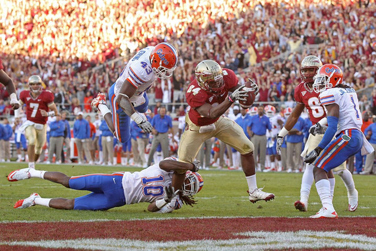 TALLAHASSEE FL - NOVEMBER 27: Lonnie Pryor #24 of the Florida State Seminoles rushes for a touchdown during a game against the Florida Gators at Doak Campbell Stadium on November 27 2010 in Tallahassee Florida.  (Photo by Mike Ehrmann/Getty Images)