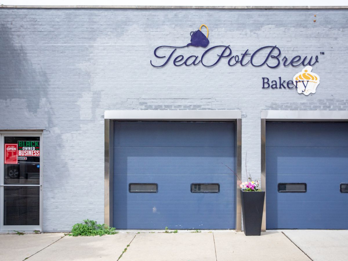 A storefront with two garage doors.