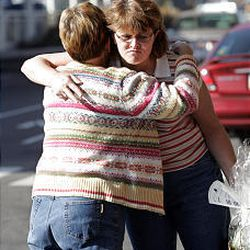 Pat Jarman, left, hugs Tammy Seegmiller at the airport. Chances are, Seegmiller's plane was on time.
