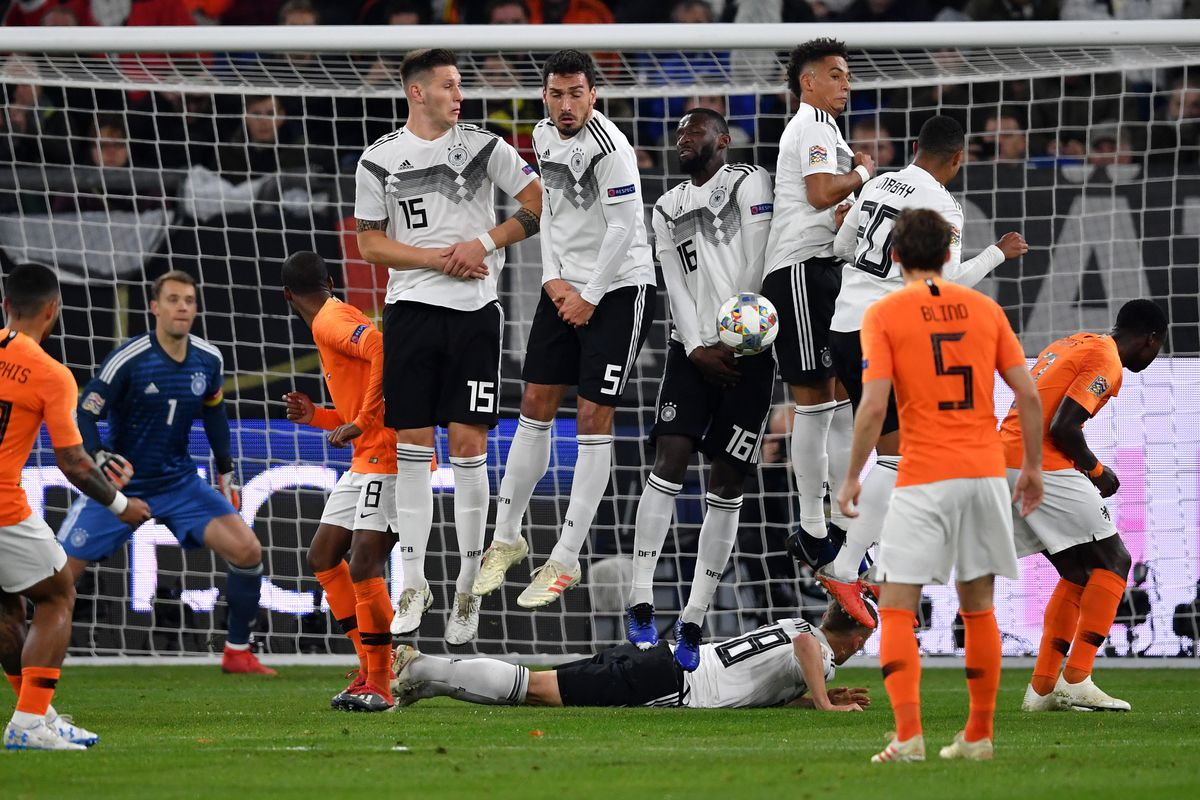 Germany v Netherlands - UEFA Nations League A GELSENKIRCHEN, GERMANY - NOVEMBER 19: Joshua Kimmich of Germany lies on the pitch behind the defensive wall as Memphis Depay of the Netherlands takes a free kick during the UEFA Nations League A group one match between Germany and Netherlands at Veltins-Arena on November 19, 2018 in Gelsenkirchen, Germany.