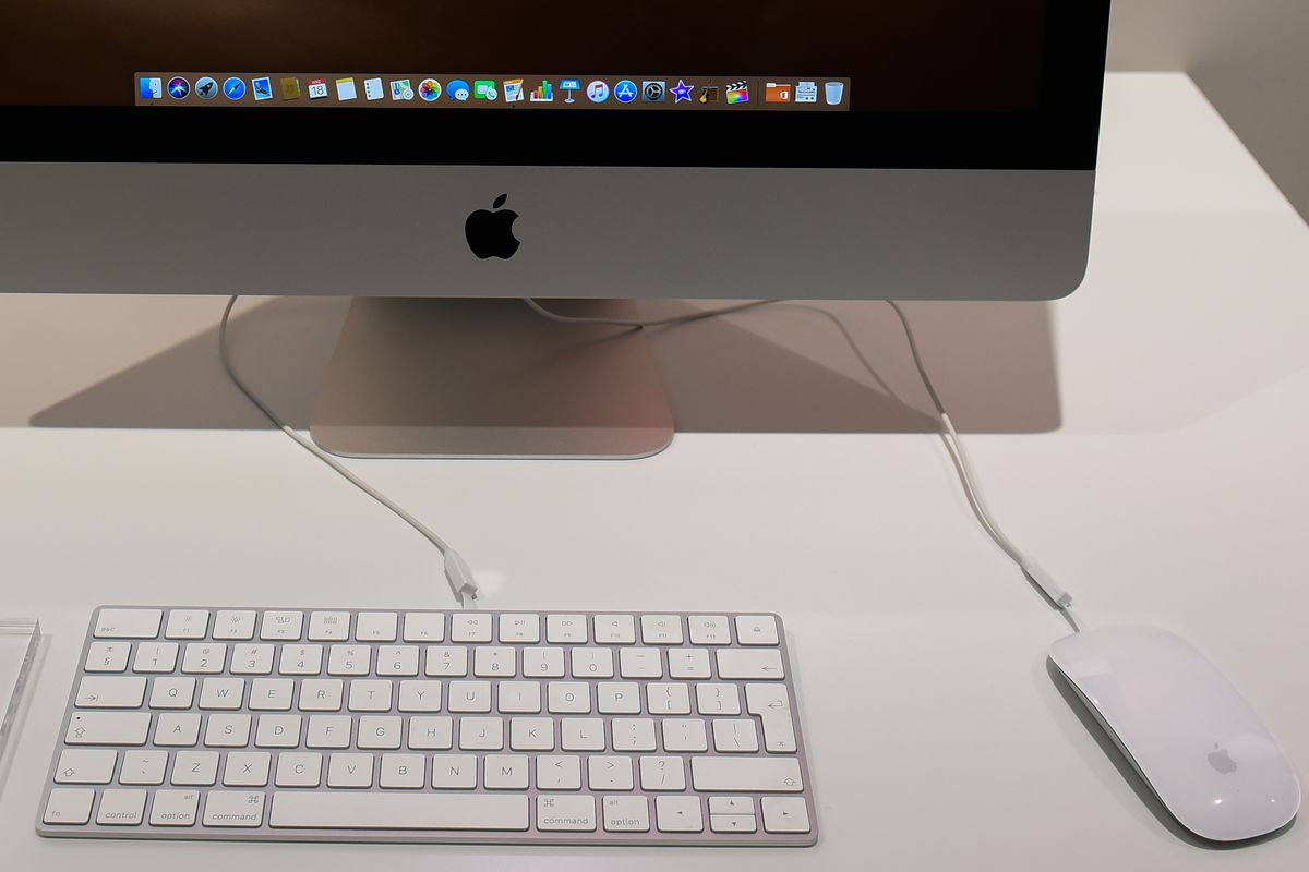 A detailed view of an iMac with keyboard and a mouse at an...