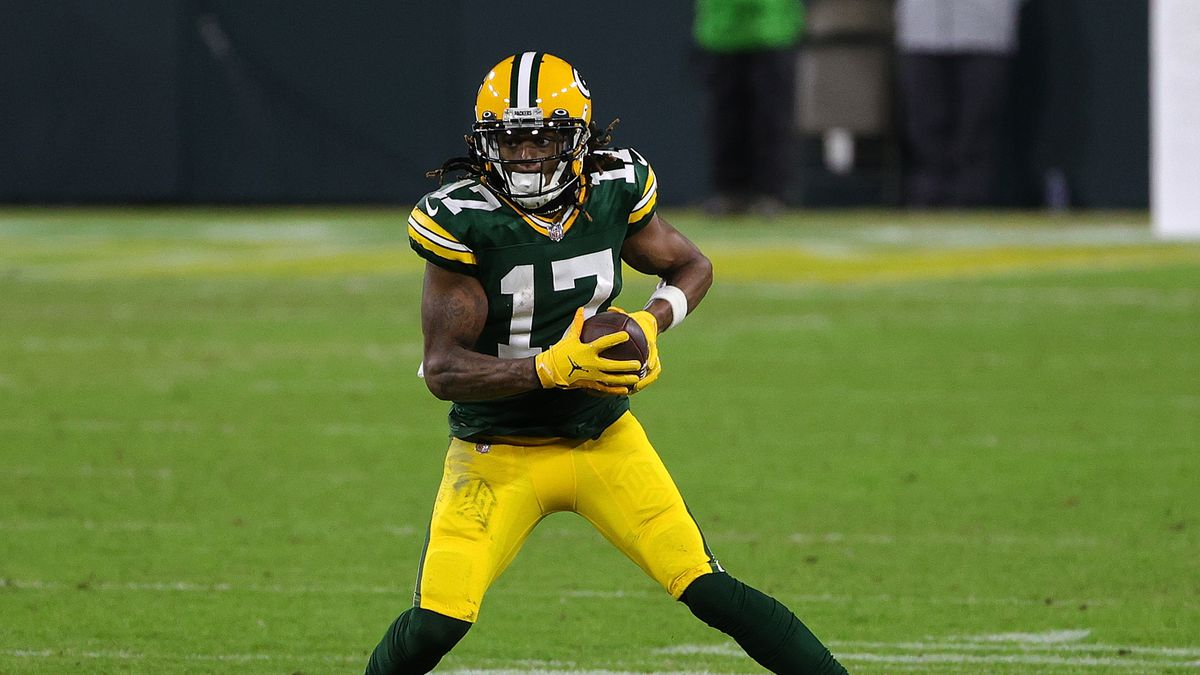 Davante Adams #17 of the Green Bay Packers runs for yards after a catch during the NFC Divisional Playoff game against the Los Angeles Rams at Lambeau Field on January 16, 2021 in Green Bay, Wisconsin. The Packers defeated the Rams 32-18.