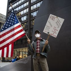 Rob Fassbender, 73, of Dixon, joins hundreds of protesters to rally in Daley Plaza before marching through the Loop to demand every vote be counted in the general election, Wednesday night, Nov. 4, 2020.