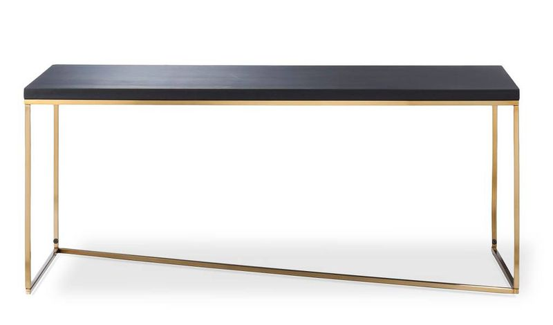 A rectangle coffee table with a matte black top and z-shaped gold base.