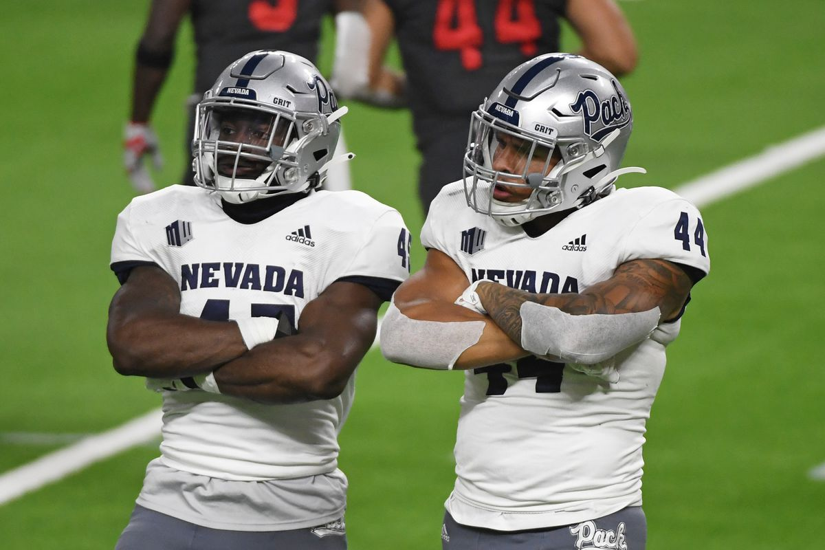 Linebacker Trevor Price #45 and defensive end Daniel Grzesiak #44 of the Nevada Wolf Pack react after Grzesiak made a tackle on a kickoff return in the second half of their game against the UNLV Rebels at Allegiant Stadium on October 31, 2020 in Las Vegas, Nevada. The Wolf Pack defeated the Rebels 37-19.