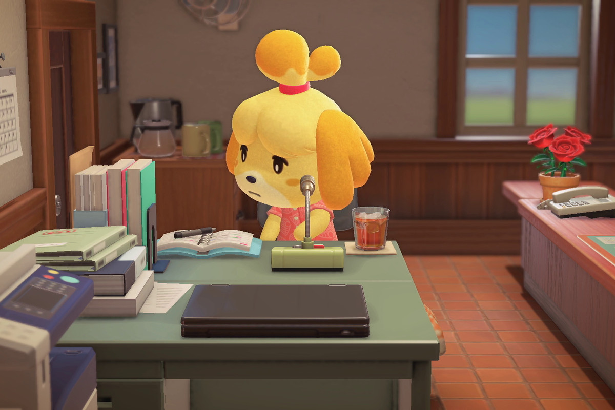 Isabelle sitting at a desk in Animal Crossing: New Horizons