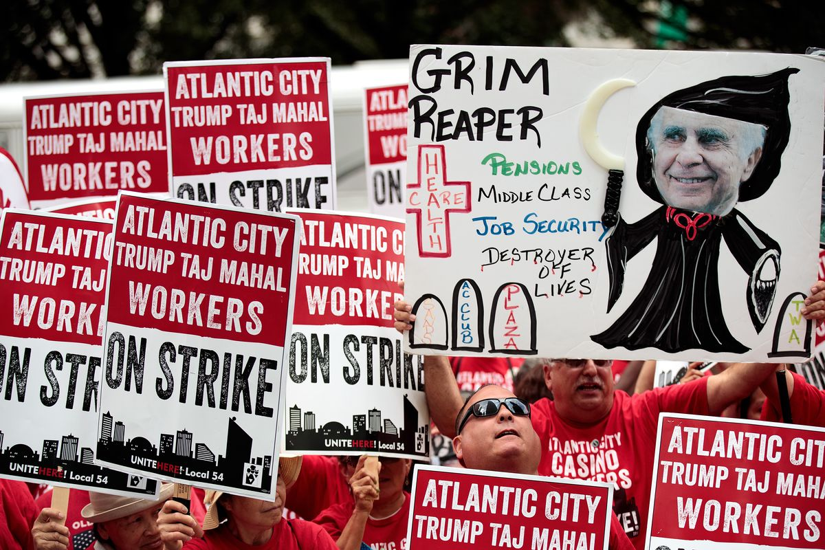 Casino workers and activists protest outside Trump Taj Mahal owner Carl Icahn's office on Fifth Avenue, July 13, 2016 in New York City. Trump Taj Mahal workers from the Local 54 Unite Here union have been on strike since July 1. The workers accuse Icahn a