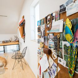 The designer keeps an inspiration board in the corner of her office.