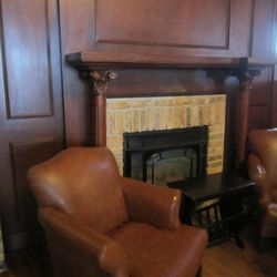 Original fireplace and seating area in the dining room.