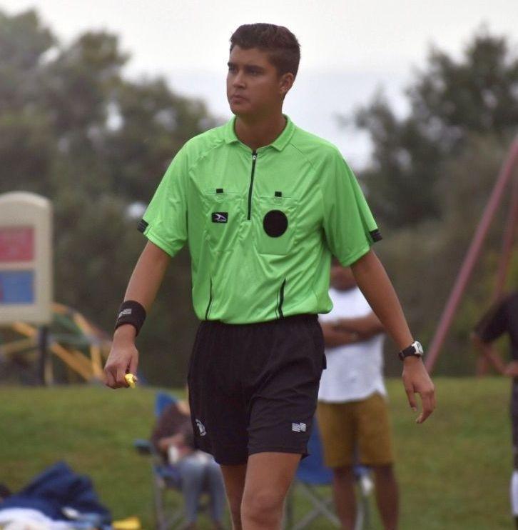 Alex Pena in a referee shirt.