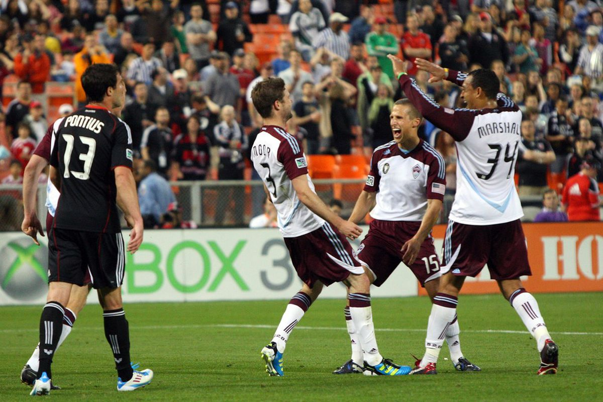 WASHINGTON, DC - MAY 14: Drew Moor #3 and Wells Thompson #15 of the Colorado Rapids celebrate after a goal against D.C. United at RFK Stadium on May 14, 2011 in Washington, DC. (Photo by Ned Dishman/Getty Images)