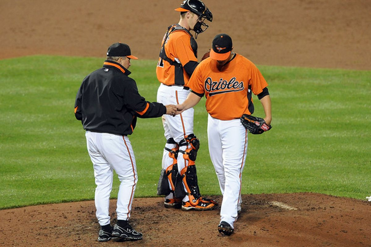 Dave Trembley of the Baltimore Orioles removes David Hernandez from the game, and probably the rotation. (Photo by Greg Fiume/Getty Images)