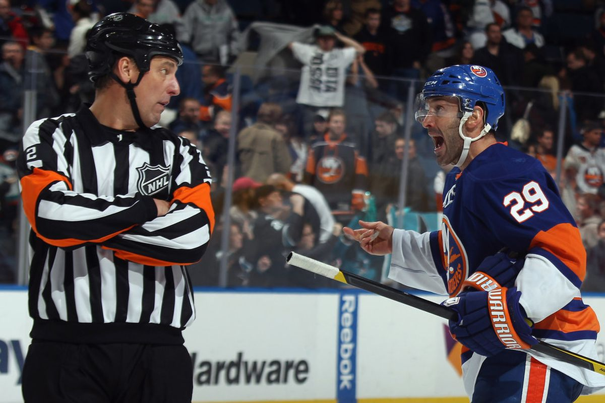 With great perseverance and no small degree of dedication, Jay Pandolfo explains how Travis Hamonic <em>did not</em> clear that puck directly over the glass.