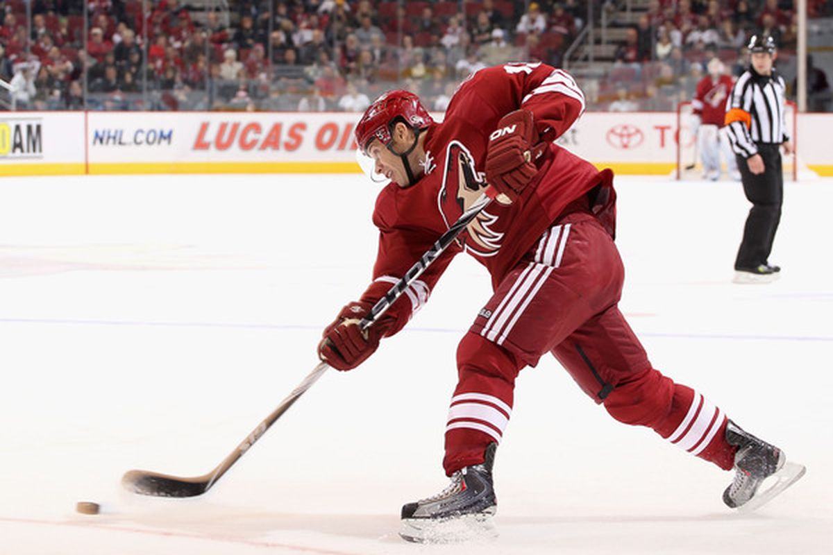 GLENDALE AZ - DECEMBER 04:  Ray Whitney #13 of the Phoenix Coyotes shoots the puck against the Florida Panthers during the NHL game at Jobing.com Arena on December 4 2010 in Glendale Arizona.  (Photo by Christian Petersen/Getty Images)
