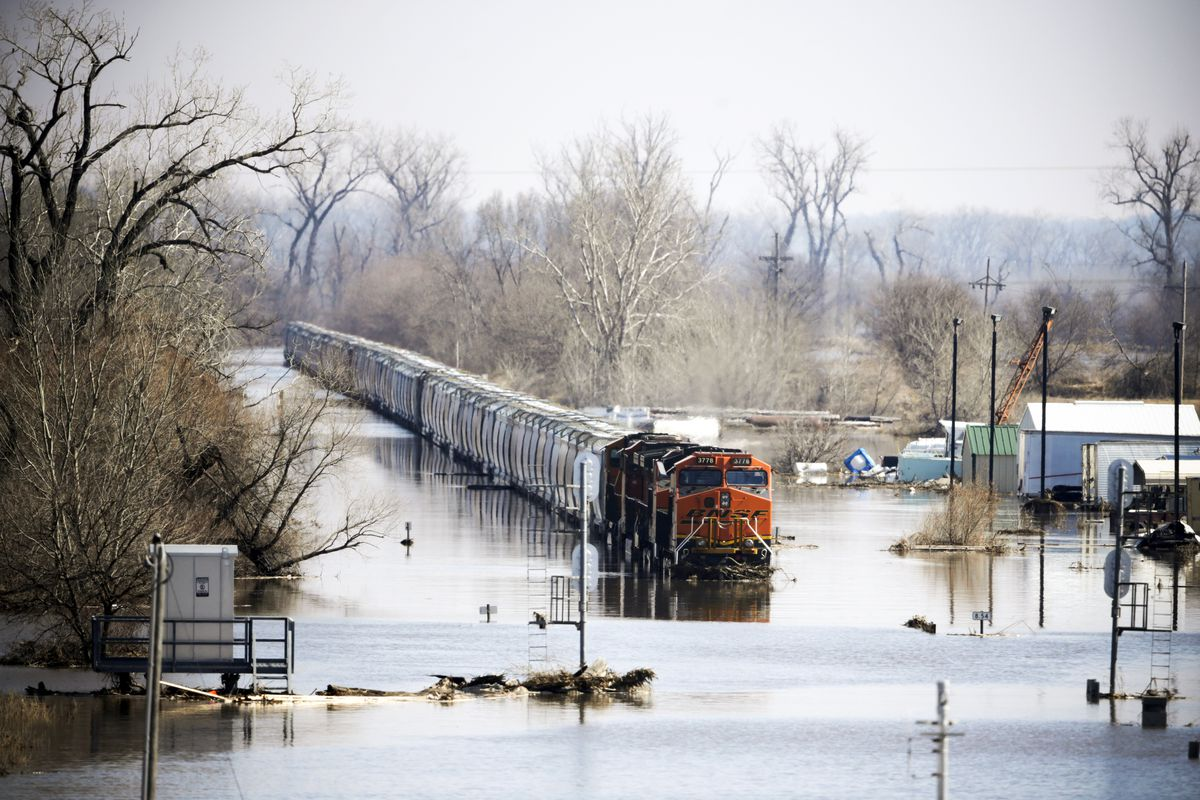 A freight train sits idle in flood waters from the Platte River, in Plattsmouth, Nebraska on March 17, 2019.
