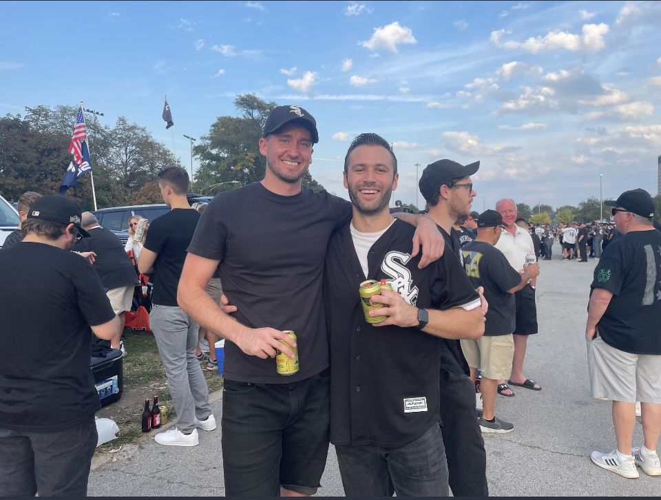 Patrick Elget (right) with his friend in a parking lot outside Guaranteed Rate Field.