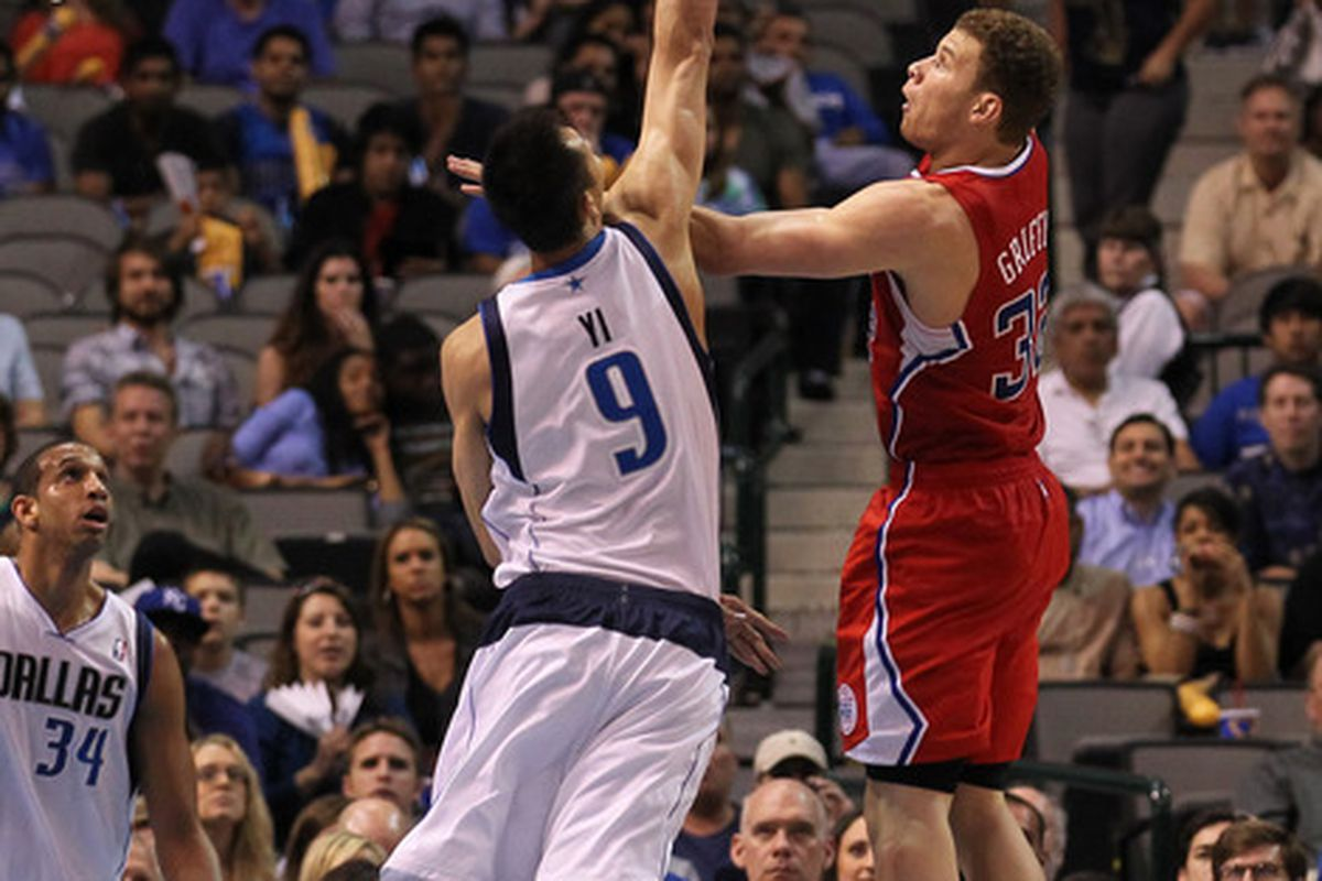 April 2, 2012; Dallas, TX, USA; Los Angeles Clippers forward Blake Griffin (32) shoots in the fourth quarter against Dallas Mavericks forward Yi Jianlian (9) at American Airlines Center.  Mandatory Credit: Matthew Emmons-US PRESSWIRE