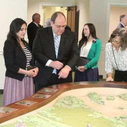 Sister Destiny Agado, left, a missionary guide at the visitors' center of Priesthood Restoration site, explains model of the site as Dale Chamberlain, Nazareth, Pennsylvania; and Leslie Kunz, Downingtown, Pennsylvania, look at the model following dedication of the site on Sept.19, 2015.
