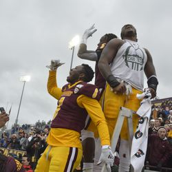 Jonathan Ward, Michael Oliver and Da'Quaun Jamison lead CMU in the traditional performance of the fight song post-victory.