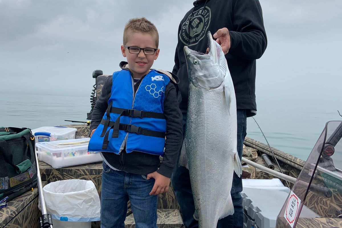 John Kristin, 8, caught his first Chinook; it was big enough at 26 pounds to take help holding. Provided photo