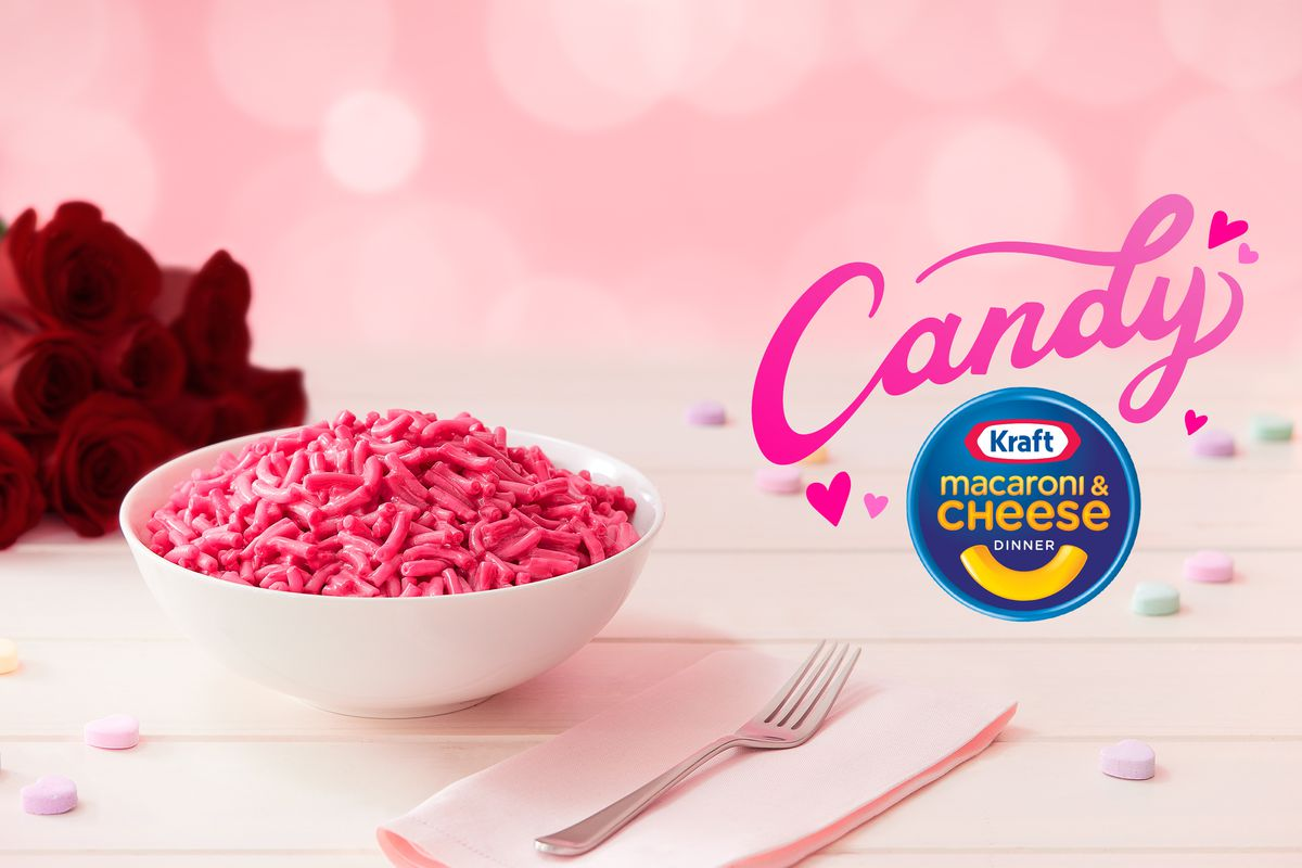 A bowl of pink macaroni and cheese next to the Kraft logo