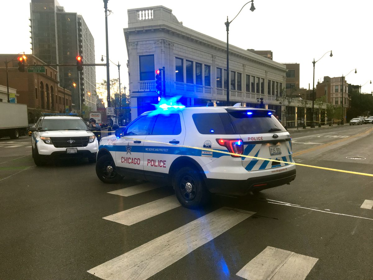 Police SUVs in the intersection of Halsted Street and Lincoln Avenue.