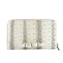 """<strong>7. RK New York RingBag Snake Clutch, <a href=""""http://www.circleandsquaresf.com/store/ringbag-snake-paneling-white.html """">$545</a></strong>   This snakeskin clutch works as the perfect day to night bag with built in rings to dazzle your fingers a"""