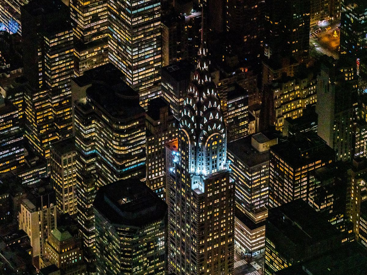 The top of a tall building at nighttime.