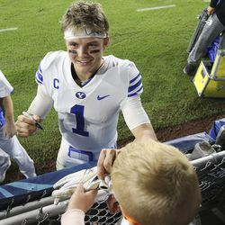 Brigham Young Cougars quarterback Zach Wilson (1) signs an autograph for a young fan after the Boca Raton Bowl in Boca Raton, Fla., on Tuesday, Dec. 22, 2020. BYU won 49-23.