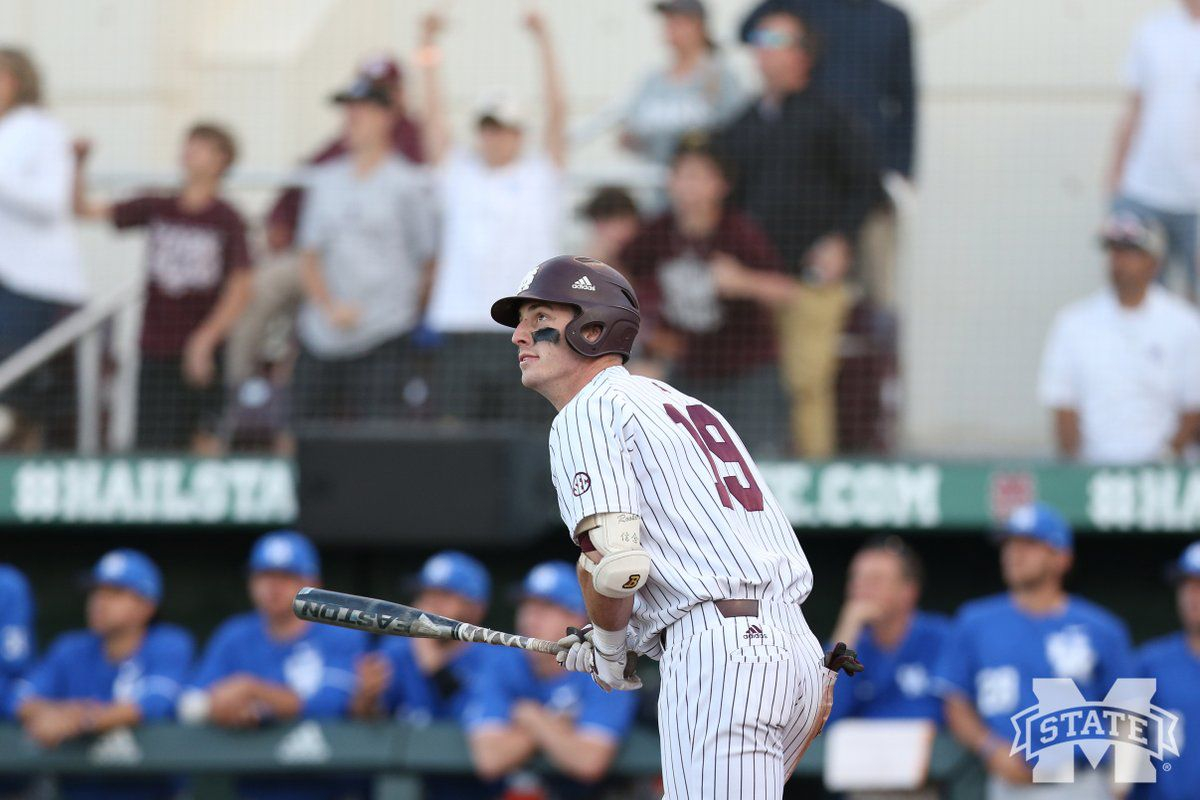 Brent Rooker watches a baseball leave Dudy Noble Field after hitting a grand slam to take the lead against Kentucky.