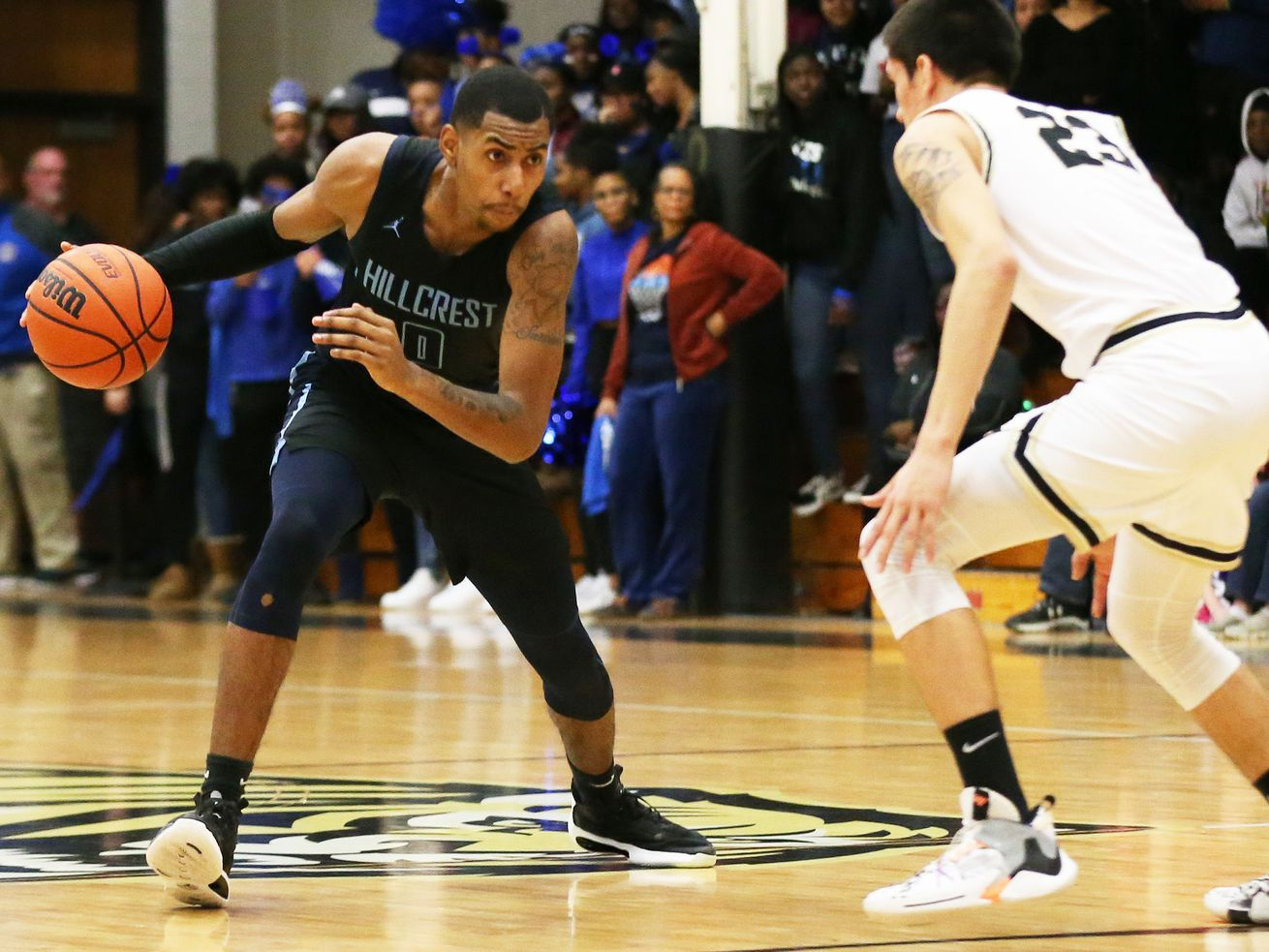 Hillcrest's Julius Rollins (0) controls the ball as Oak Forest's Juan Avila defends. Rollins is expected to sign with Kent State this week.