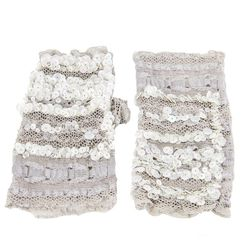 """White sequin gloves pretty much scream NYE. <a href=""""http://www.circleandsquaresf.com/store/moonshine-lace-fingerless-gloves-sequin-delica-beads-and-recycled-lace.html"""">$360</a> at Circle & Square in Presidio Heights"""