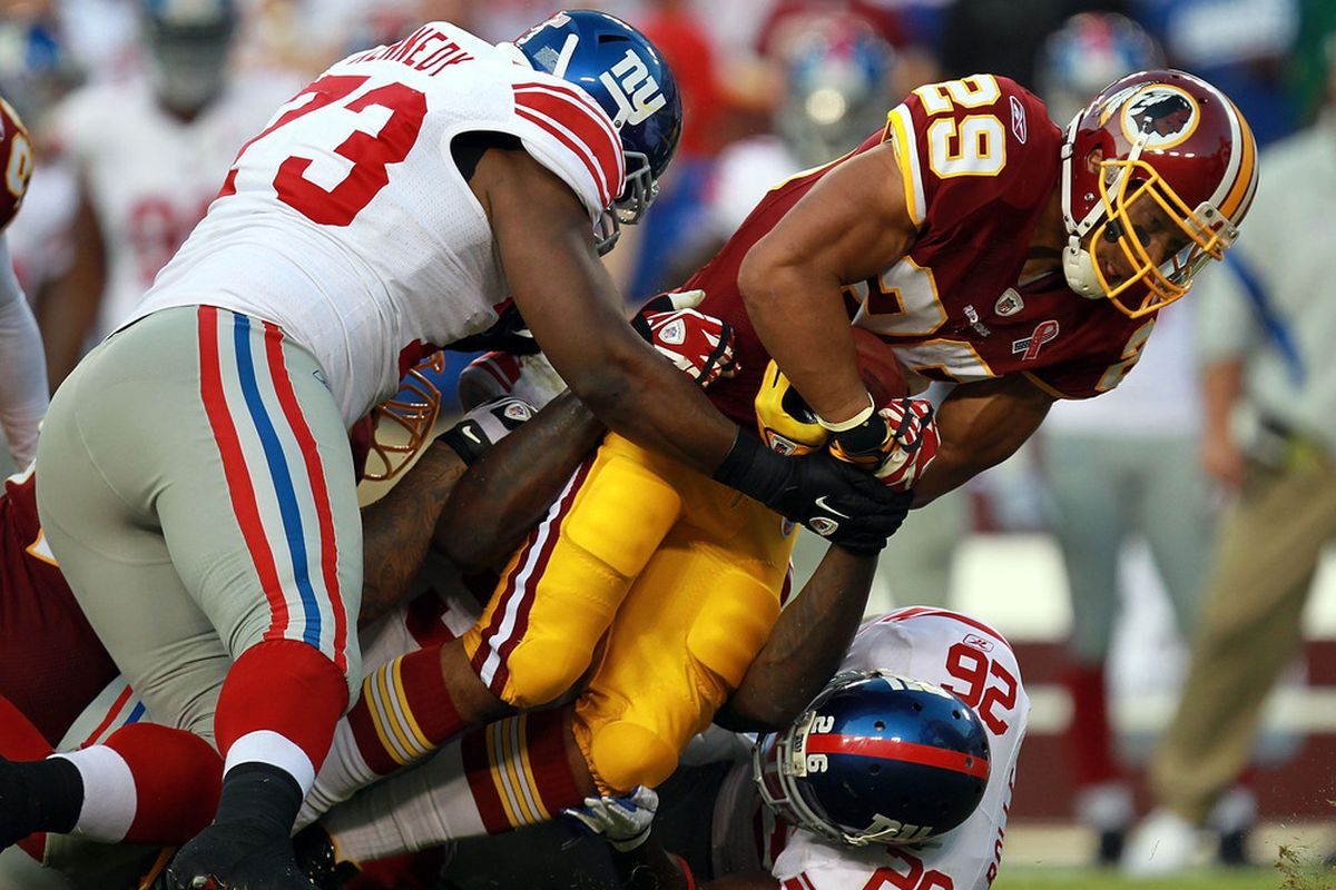 Jimmy Kennedy of the New York Giants makes a tackle against the Washington Redskins in a game earlier this season.  (Photo by Ronald Martinez/Getty Images)