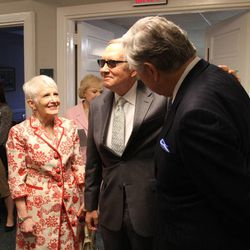 Sen. Harry Reid, center, and wife Landra Reid speak with Sen. Larry Pressler, right, a three-term senator who represented the state of South Dakota, following Pressler's baptism Sunday, April 19, 2015, in Chevy Chase, Maryland.