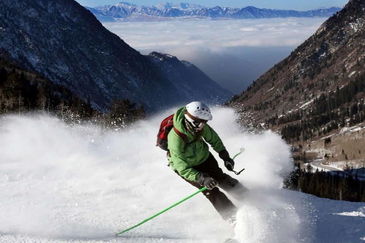 In this 2011 file photo, a skier glides by at Snowbird with an inversion blanketing the valley in the background.